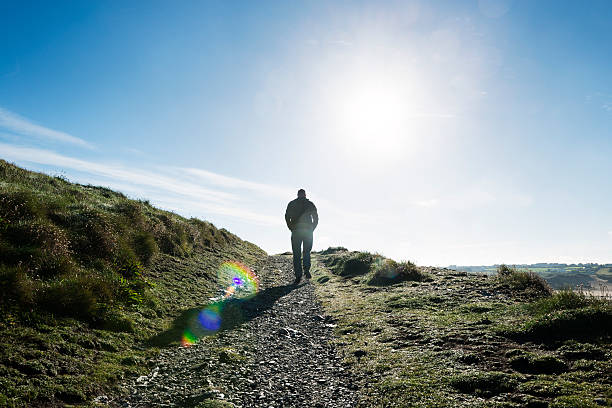 man walking the coast footpath, newquay, cornwall - cornwall stock pictures, royalty-free photos & images