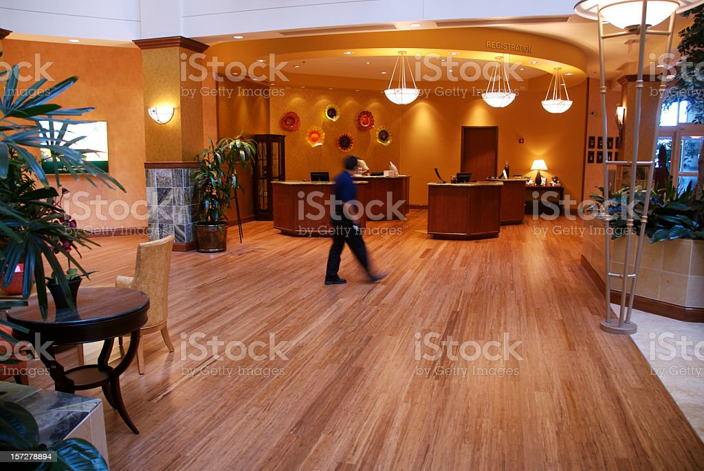 Man walking through a hotel lobby, admiring art on the wall royalty-free stock photo