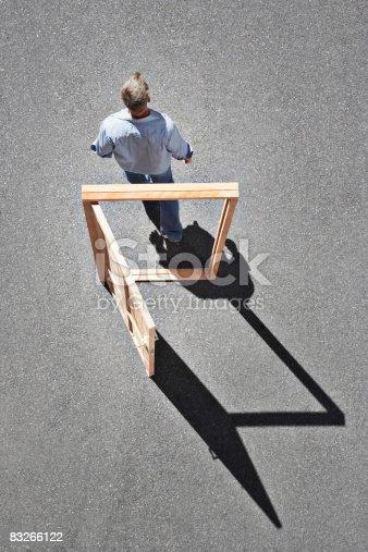 istock Man walking through door frame 83266122