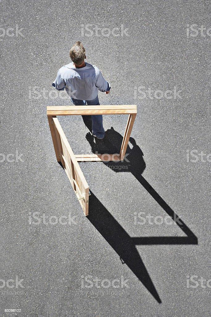 Man walking through door frame stock photo
