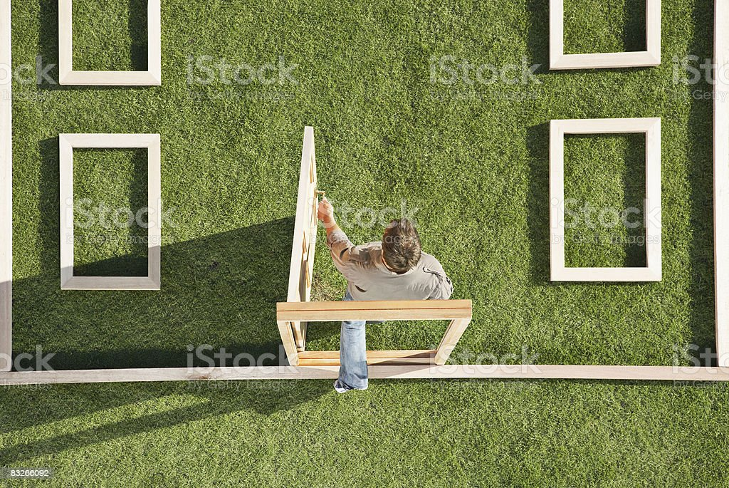 Man walking through door in house outline stock photo