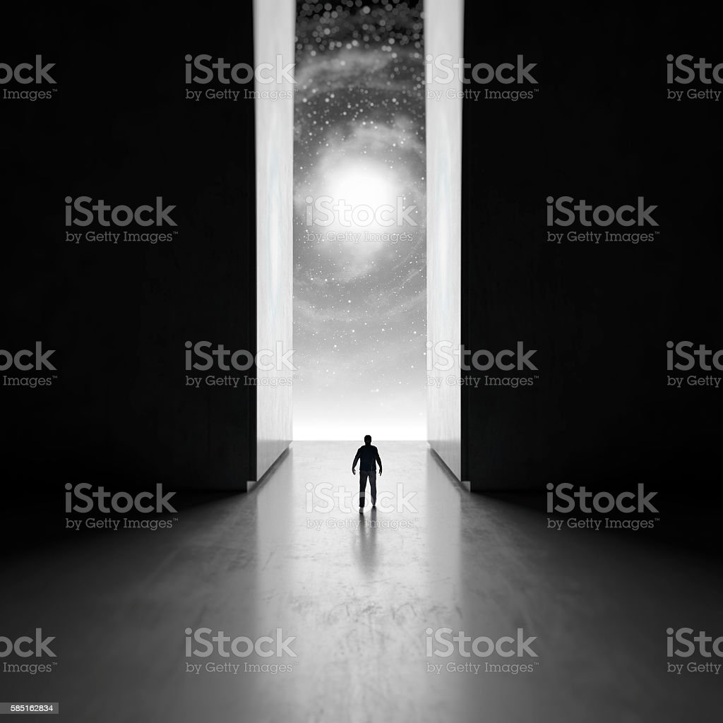 Man walking through interdimensional passage stock photo