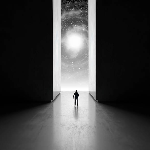 Man walking through interdimensional passage Man walking through interdimensional passage. black hole stock pictures, royalty-free photos & images
