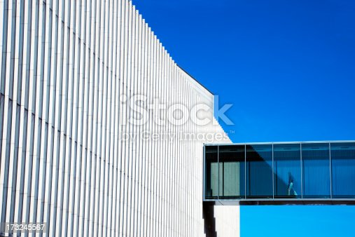 istock Man Walking Through Skywalk in Futuristic Building 173245567
