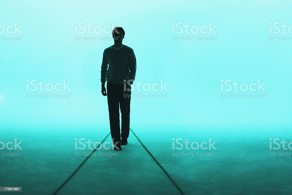Man walking towards camera stock photo