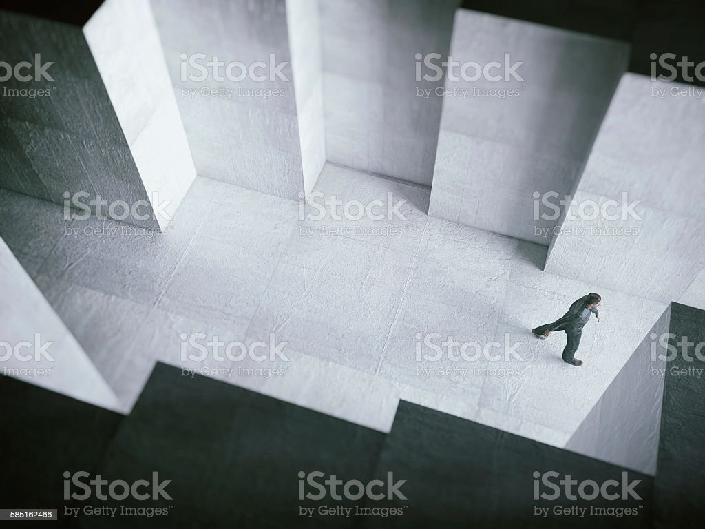 Man walking towards the light stock photo