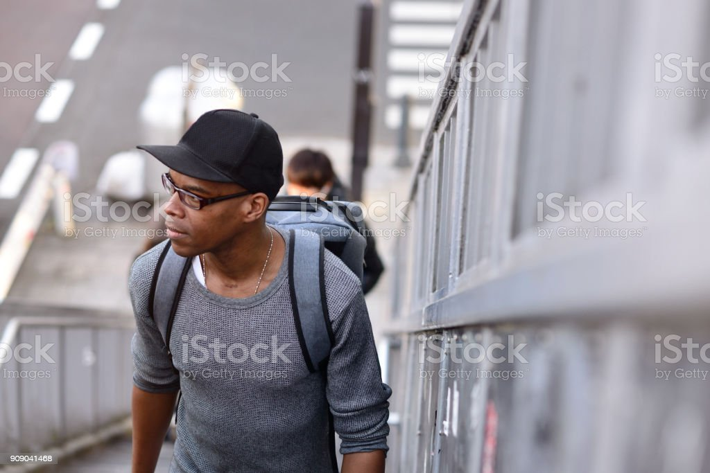 Man walking up a set of stairs stock photo