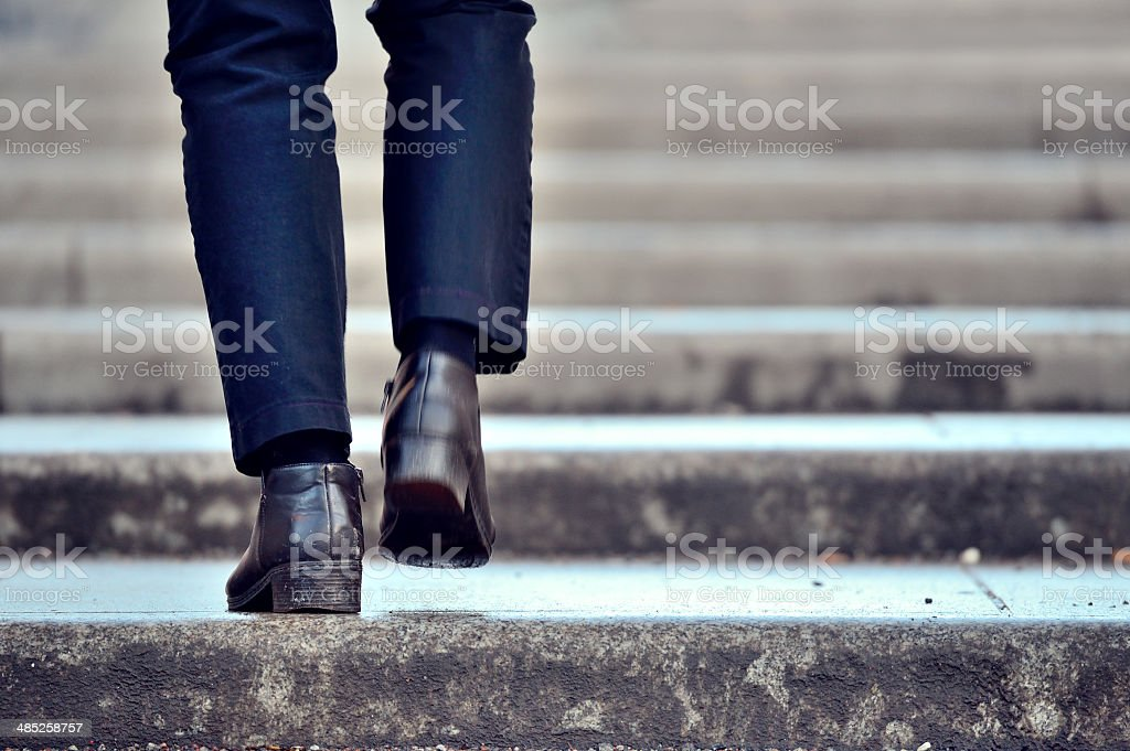 Man walking up the stairs stock photo