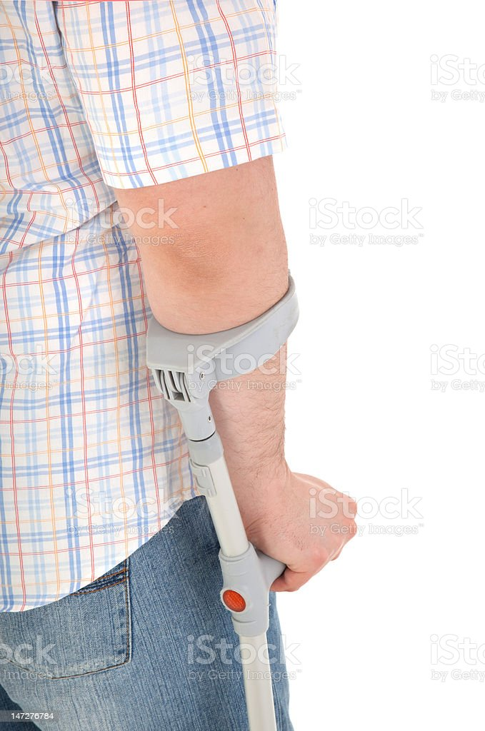man walking with a crutch against white background royalty-free stock photo