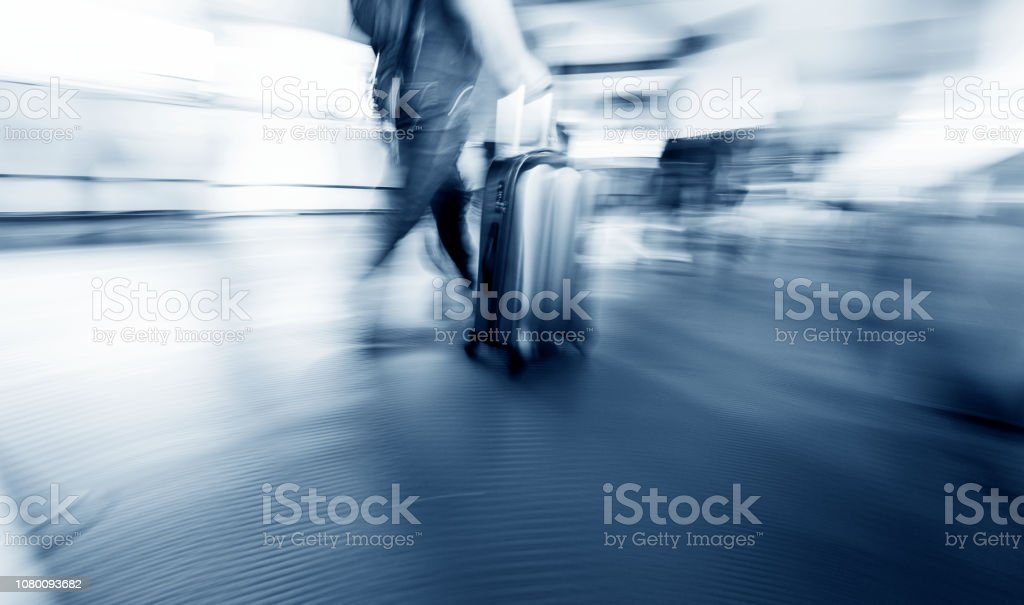 Man walking with a suitcase stock photo
