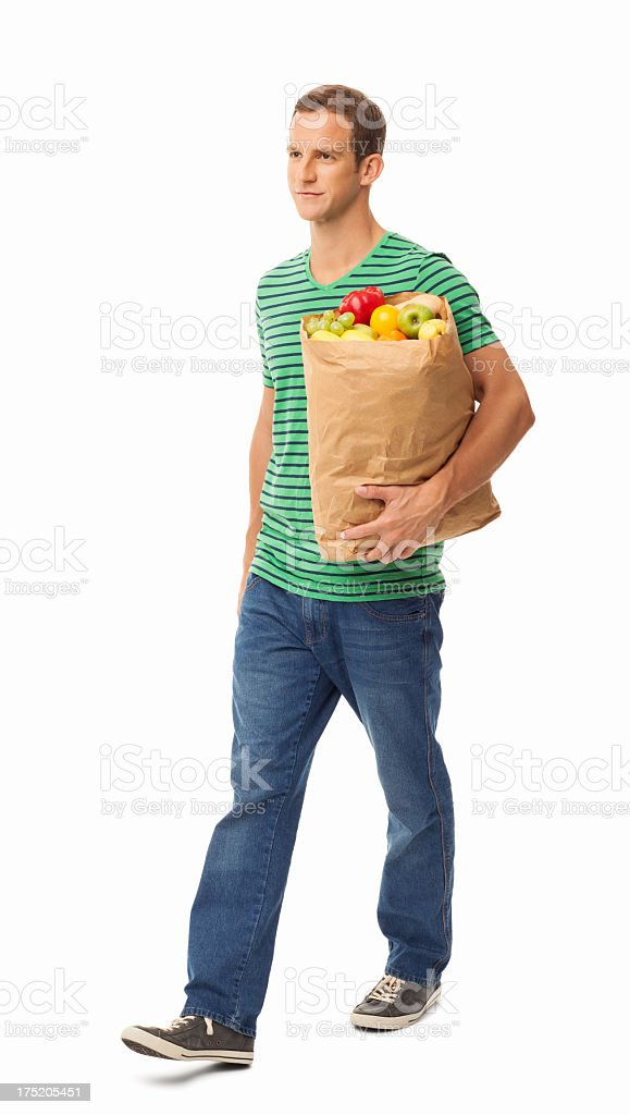 Man Walking With Bag Of Groceries - Isolated stock photo