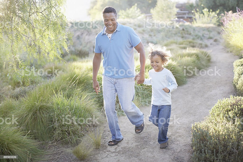 Man walking with son on trail royalty-free stock photo
