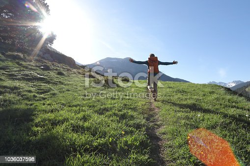 Man walks freely along pathway in the mountains of Andorra