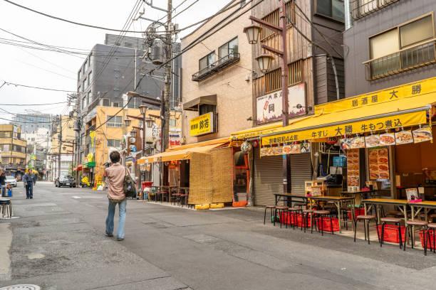 A man walks along the famous Hoppy Dori street in Asakusa stock photo