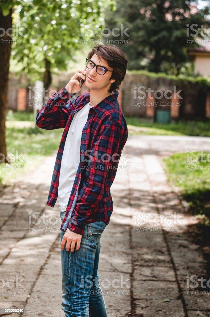 A man walks and talks on phone