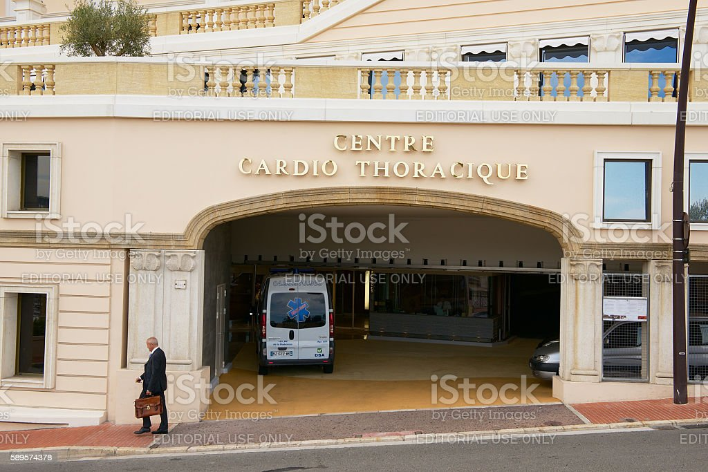 Man walks in front of the Cardio Therapy centre,Monaco. - Photo