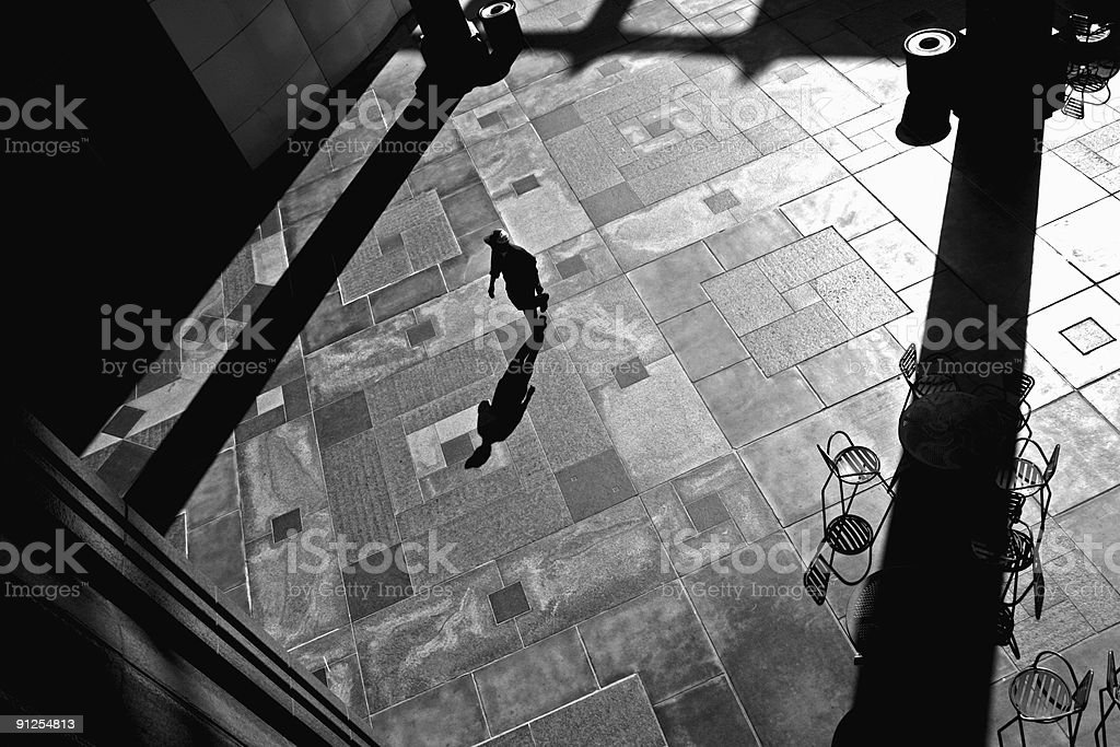 Man walks through courtyard royalty-free stock photo