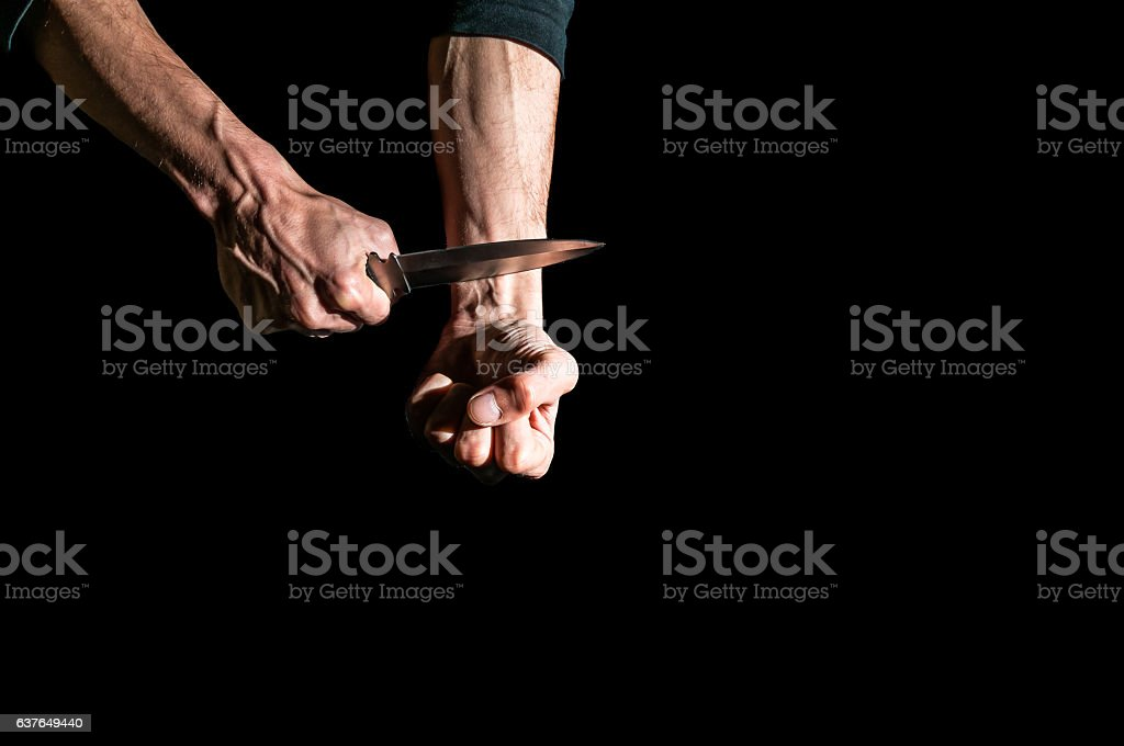 Man want to commit suicide by cutting his veins stock photo