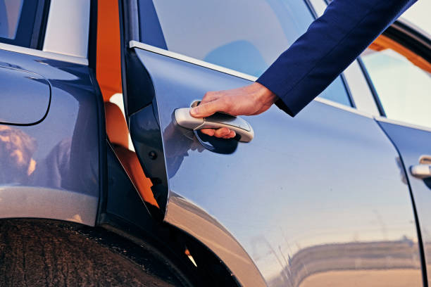 Man wants to open a gasoline tank. Close up image of a man opens car's door. luxury car stock pictures, royalty-free photos & images