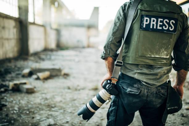 Man war journalist with camera stock photo
