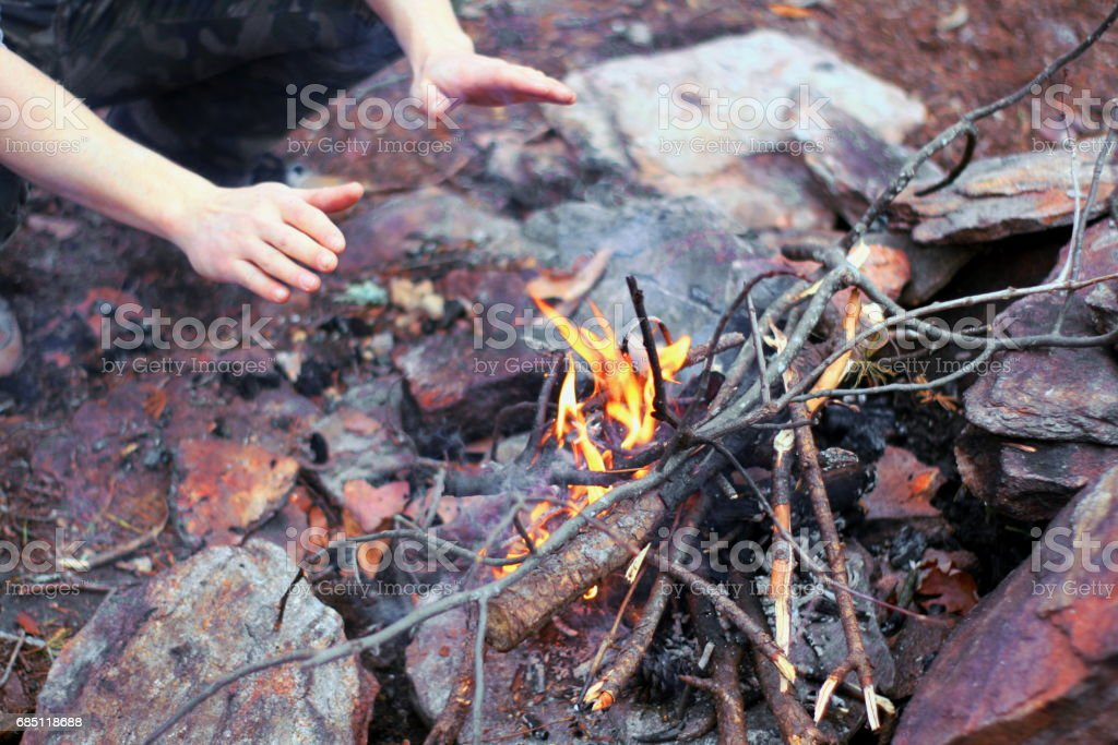Man Warming Hands Near Fire royalty-free stock photo