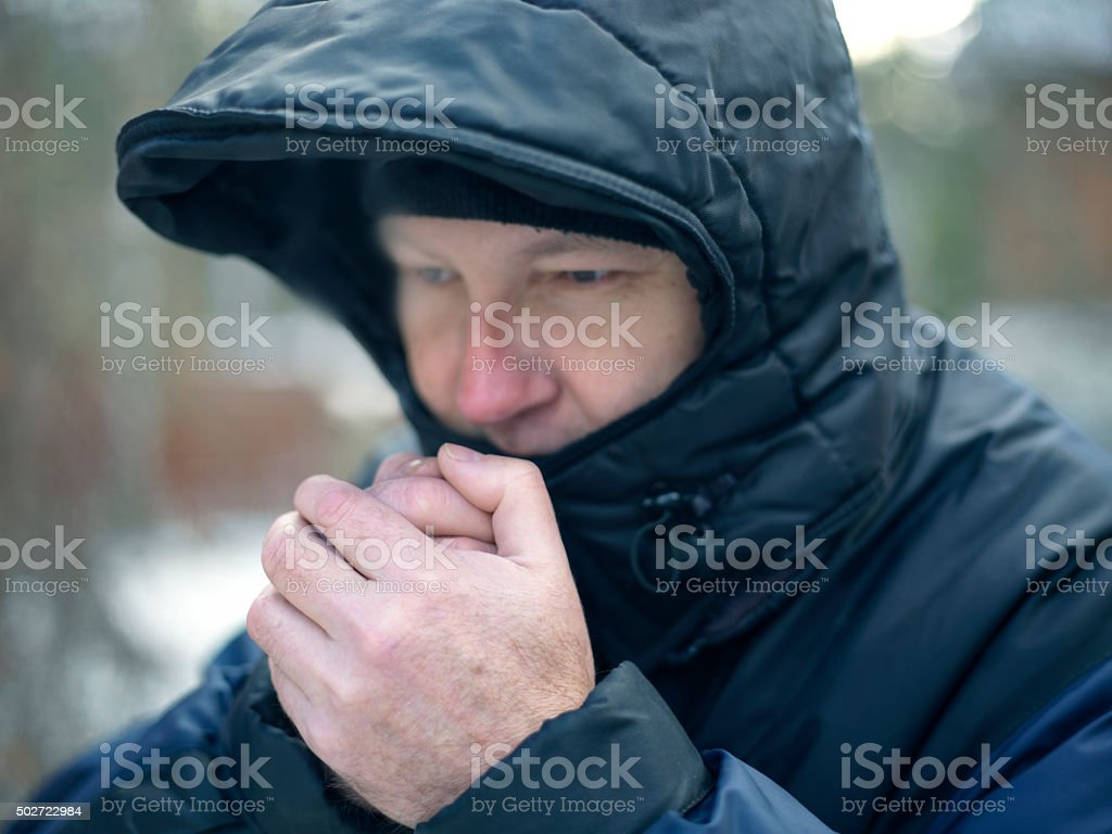 Man Warming Hands stock photo