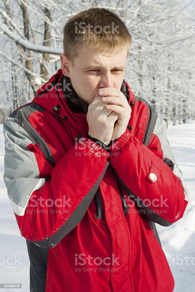 Man warming up his hands royalty-free stock photo