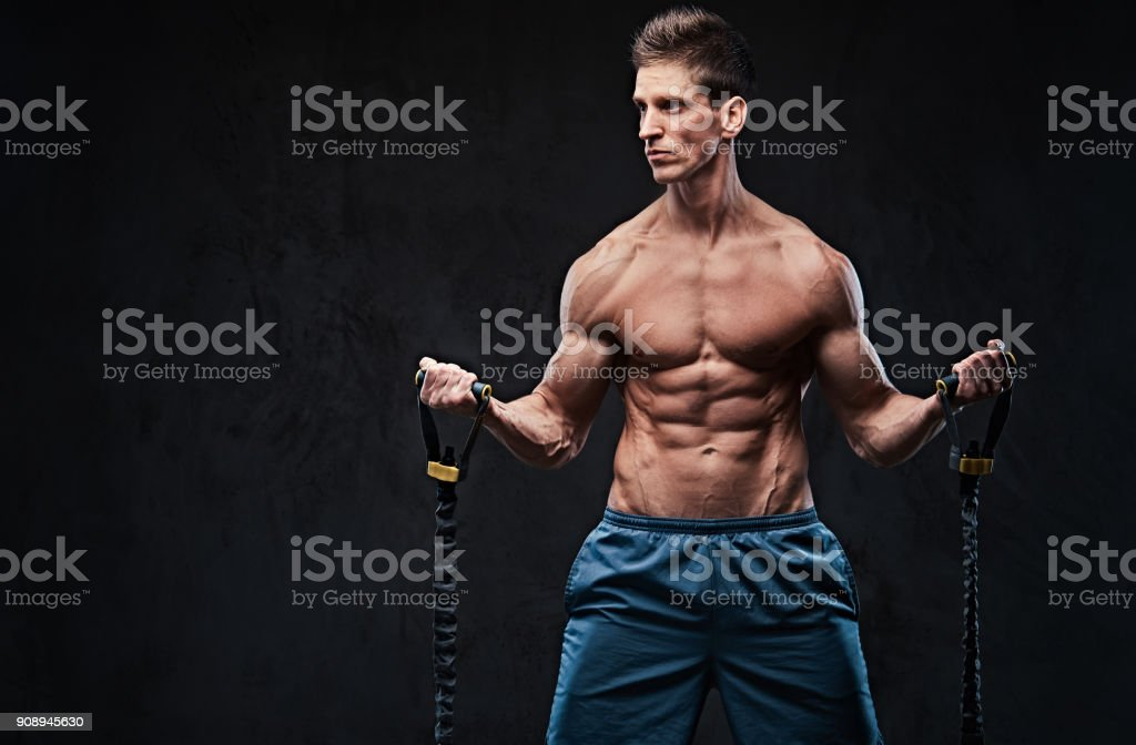 A man warms up with the latex resistance band. stock photo