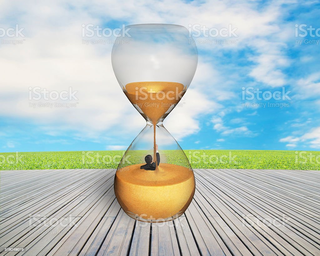 man was flooded in hourglass stock photo