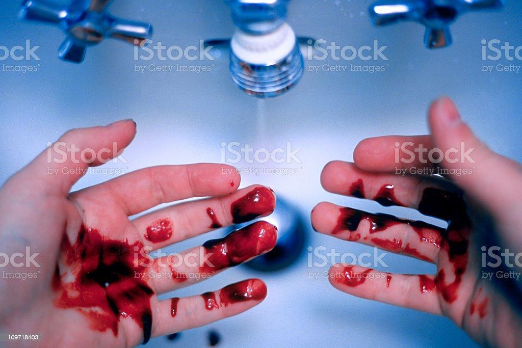 Man Washing Blood off Hands - Murder/Guilt Concept stock photo