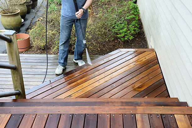 man washing deck - high pressure cleaning stock photos and pictures