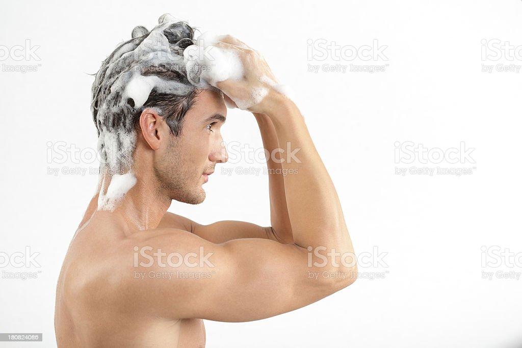 Man washing hair with shampoo royalty-free stock photo