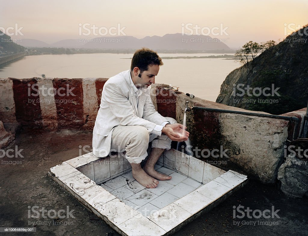 Man washing hands and feet foto royalty-free