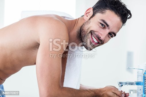 istock Man washing his face in sink 846370322