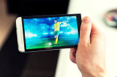 Man watches a football match on phone