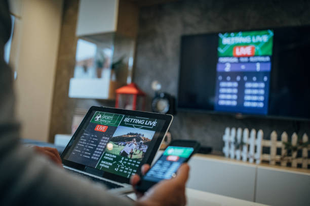 Man watches soccer game and bets in his living room stock photo