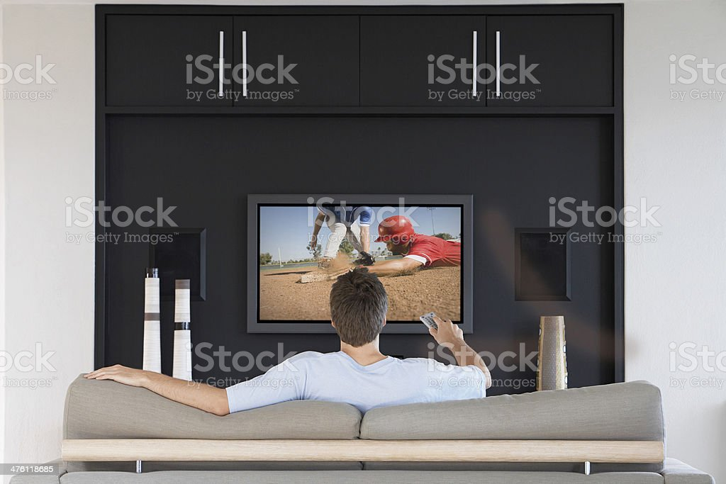 Man watching Baseball on television stock photo
