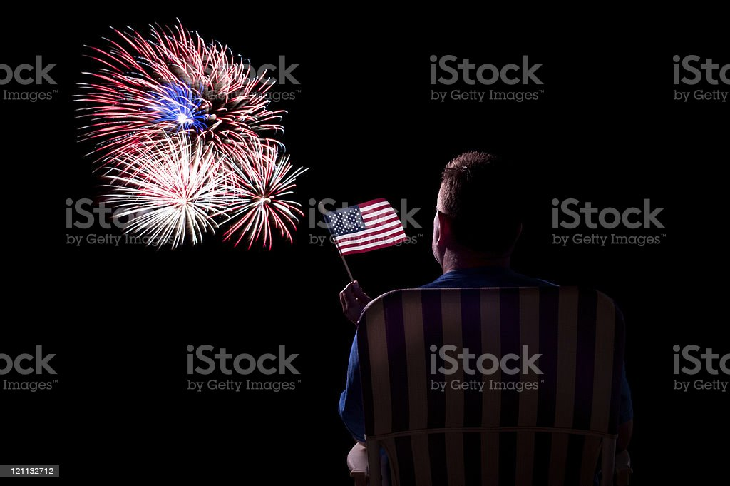 Man watching fireworks stock photo