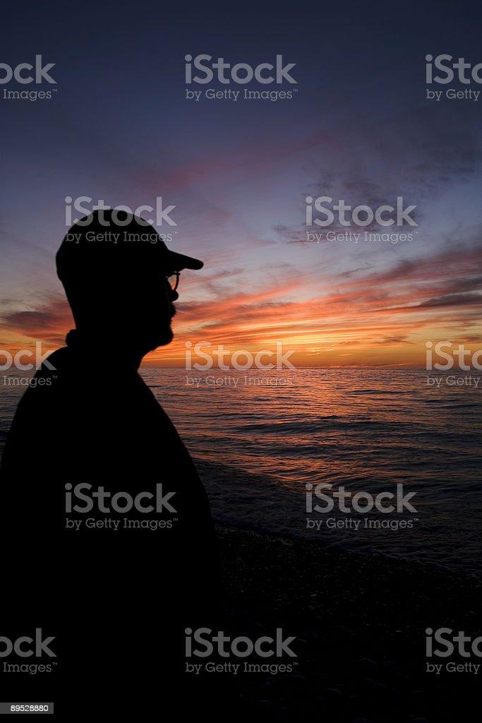 Man Watching Lake Superior Sunset 2 royalty-free stock photo