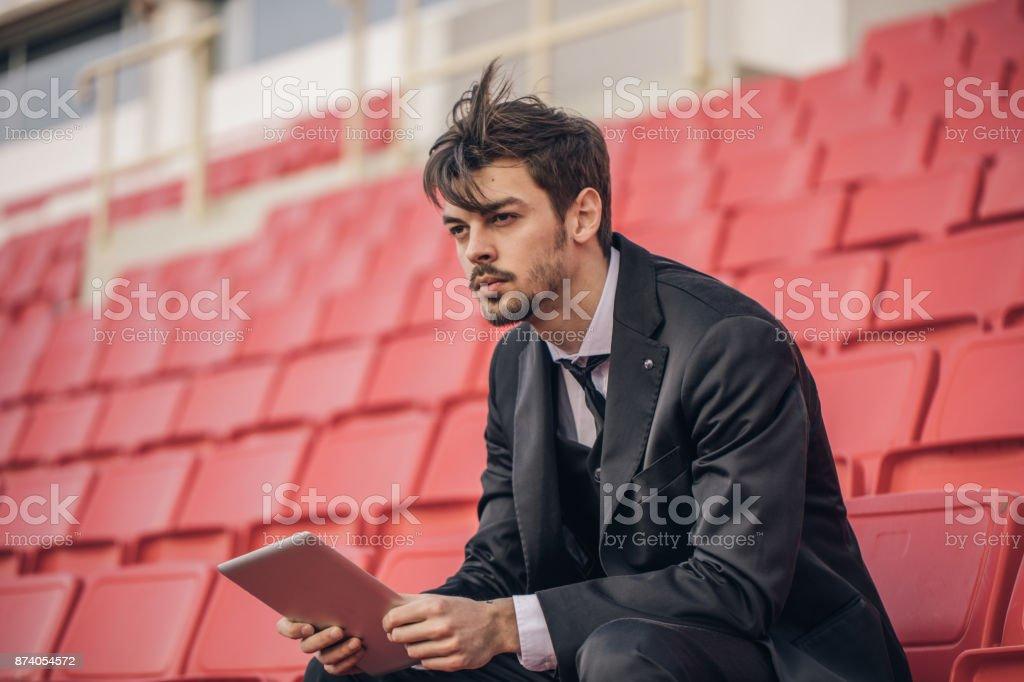 Man watching match on stadium stock photo