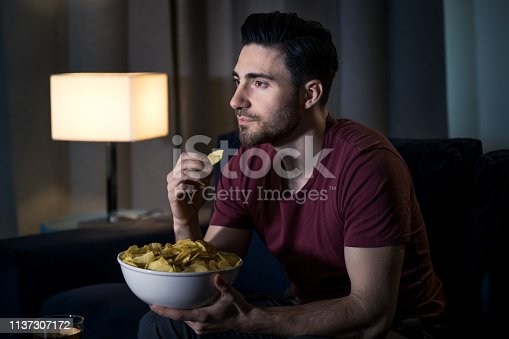 Young man relaxing by watching movie