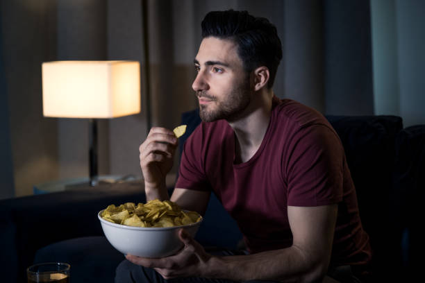 Man watching movie at home stock photo