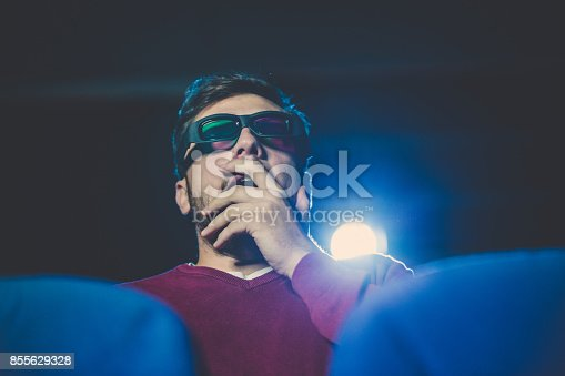 istock Man watching movie in theater 855629328