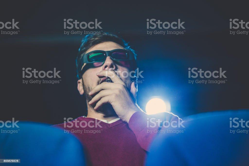 Man watching movie in theater stock photo