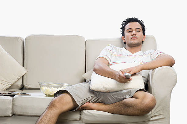 man watching television and looking surprised - laziness stock photos and pictures