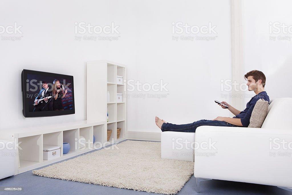 Man Watching Television - Royalty-free 'at' Symbol Stock Photo