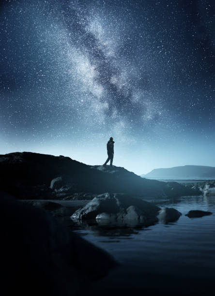 A Man watching The Night Sky stock photo
