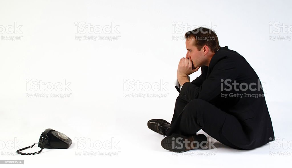 Man watching the phone waiting on an expected call  royalty-free stock photo