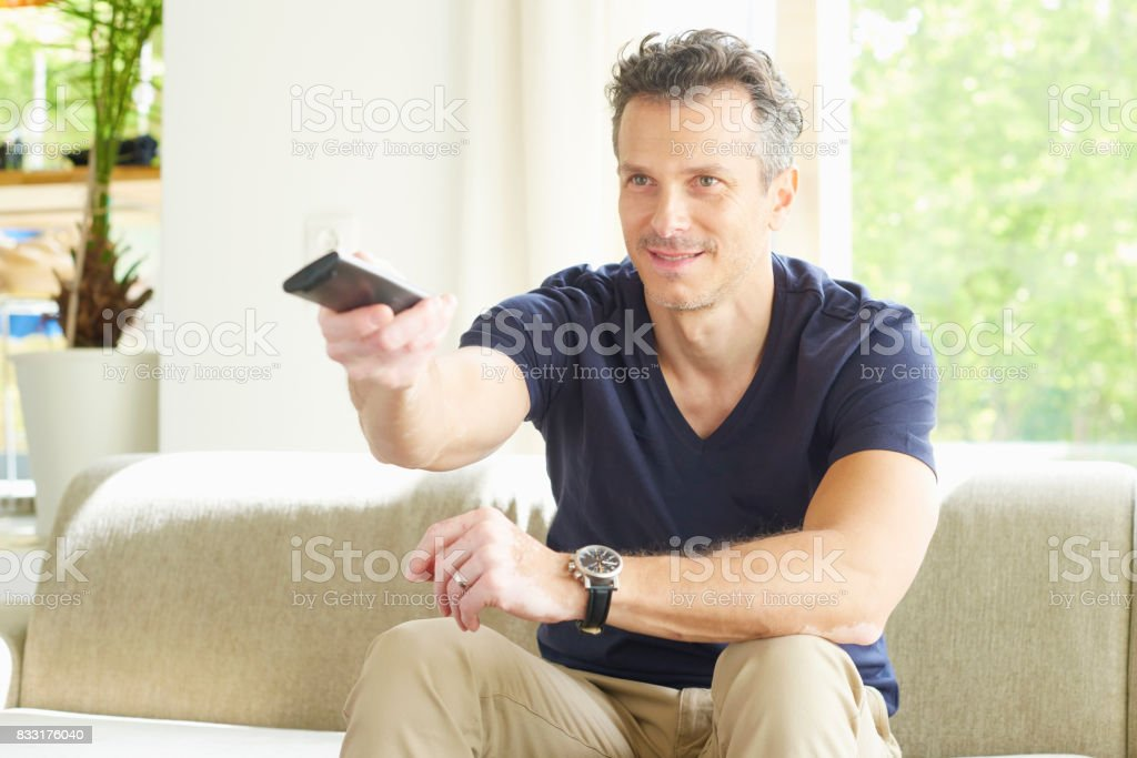 Man watching the tv stock photo