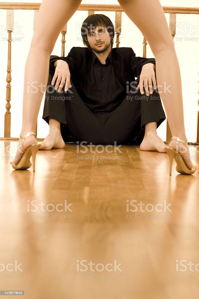 man watching through women's legs royalty-free stock photo